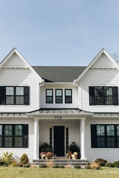 Front view of a southern style home, with white siding and black window treatments Black Windows Exterior, White Exterior Houses, Exterior Siding, Black Exterior, White Houses, Exterior Paint, White Siding House, House Shutters, Homes With Shutters