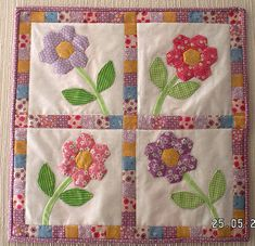 grandmother's flower garden mini quilt - like the stems and leaves