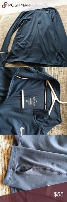 Nike long sleeve half zip Never worn long sleeve Nike running dri fit half zip. Really nice, I just don't need it! Nike Shirts Tees - Long Sleeve