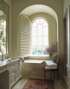 Arched shutter. Perfect window treatment for any bathroom. Light when you want it and privacy when you need it!