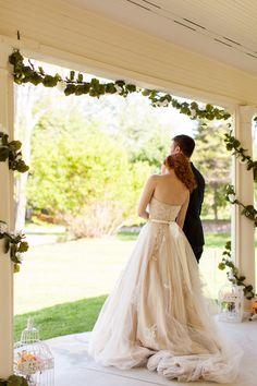 #brideandgroom #porchwedding #farmhousewedding #floralgarland #weddingdress #longtrain