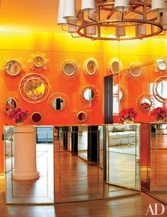 Brightly orange lacquered walls excitedly greet guest in the lobby- a perfect welcome for the creative type that enter Burch's creative confines | On MyDesignSource Blog