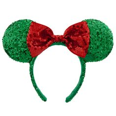 Disney Holiday Minnie Mouse Ear Headband with Bow | Disney StoreHoliday Minnie Mouse Ear Headband with Bow - Make your merry season even sweeter with Mickey's sweetie and her sequined holiday headband. Minnie's trademark ears and bow have turned green and red with a touch of holly for a festive fashion topper