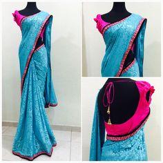 Blue georgette self patterned brasso saree  Price : 94 SGD