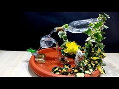 How to make a Fountain using a Glass Bottle / DIY Wine Bottle Fountain, Diy Water Fountain, Bottle Garden, Fountain Ideas, Liquor Bottles, Glass Bottles, Homemade Waterfall, Outside Fountains, Homemade Water Fountains