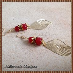 Check out this item in my Etsy shop https://www.etsy.com/listing/240149704/leaf-earrings-red-earrings-gold-leaf-and