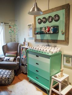 DIY painted dresser in green with an ombre effect with a matching green pegboard set into a barn wood frame. Note the stylish DIY pouf made from throw rugs.