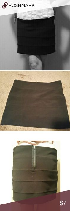 Black bandage mini skirt DETAILS: Closet Staple! black bandage skirt with back zipper detail. Sexy! Just the right amount of stretch! First picture is stock photo, the rest are the actual item. --- MATERIALS: 95% polyester and 5% spandex --- MEASUREMENTS: 14 inches long 18 inches wide --- CONDITION:  Like New --- CONCERNS: none. --- ***I welcome ALL offers and do bundle discounts!*** Ambiance Apparel Skirts Mini