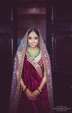 Bridal Portrait - Divya Vithika Wedding Planners | Bride in Marsala Lehenga with Gold and Emerald Jewelry | WedMeGood #wedmegood #indianjewelry #weddingbride #indianbride #lehenga #bridalportrait #portrait #marsala #velvet
