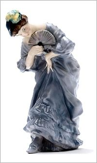 Royal Doulton Figurine Lady with Fan HN48 (1916-36) by E W Light as previously unrecorded. In a lilac dress