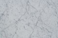 White Italian marble with grey veining. A whiter background colour with more defined veining than standard Carrara: White Carrara C Extra