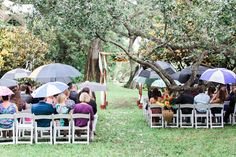 The guests were provided with umbrellas and stayed dry as the loving couple exchange their vows! | A Rainy Day Wedding That Turned Out Amazing