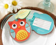 """Owl Be Seeing You"" Owl Luggage Tag. What better luggage buddy to take on a flight to good times and great memories! Say ""thank you"" to your guests with our cutely crafted, colorful owl at year-round celebrations, like your forest friends-themed baby shower or your fun farm wedding in the fall. Features and facts:  Sturdy, rubber luggage tag with friendly faced owl design, plastic attachment loop and green, leaf-shaped card that says ""Owl"" Be Seeing You on the outside and ""What a..."