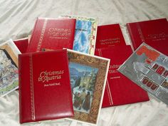 "7 books from the Worldbook/Childcraft ""Christmas Around the World"".  There's Christmas in New England, the Netherlands, Ireland, Austria, Denmark, Washington DC, and Christmas in the HolyLand.  Copyright 1984.  There are also Advent calendars, recipe cards, a cardboard house,"