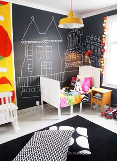 ◆ Miluccia. Use a chalkboard wall to create a little extra bit of fairytale magic for a kids room. Love the colour pop of orange and yellow against this black chalkboard. #chalkboard #kidsdecor