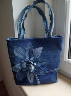 very interesting upcycled denim applique bag