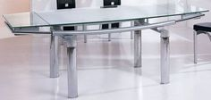 Contemporary 12 mm tempered glass expandable table. The Dinette Table is constructed of high quality materials and has a durable glass top. The Table features silver metallic tubular frame and extraordinary look, that brings glamour style to your dinning room. Features:; Contemporary design; Tubula...