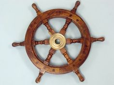 """Wood and Brass Ship Wheels 12"""" The Ships Wheel / boat steering wheel for a boat / Nautical Wall Decor / Beach Home Decoration by NauticalBeachDecor on Etsy https://www.etsy.com/listing/118227547/wood-and-brass-ship-wheels-12-the-ships"""