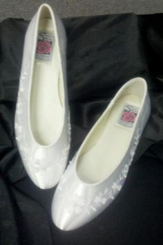 #  2  Shoe Color  White  Condition  NEW  Size  7    Original Price $79.00    Asking $15.00    Shoe description is stated as above. All shoes listed as above. All Sales are final. No refunds or exchanges. There are individual listing for each pair of shoes that correspond with appropriate size and color.    A Bridal Boutique & Tux  2243 Franklin St  Bellevue, NE 68005    Ad will be removed once shoe has been sold.