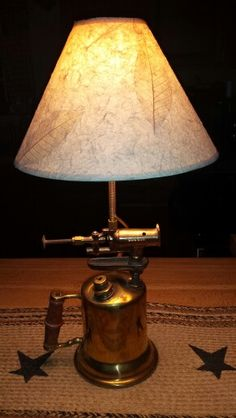Antique brass blow torch that joe repurposed into a lamp.  Beautiful!