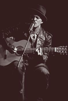 Bruno Mars  I love him!   THE BEST MUSICIAN of our generation!