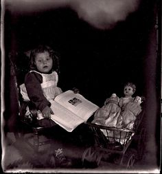 Little girl with book and dolls by sctatepdx, via Flickr
