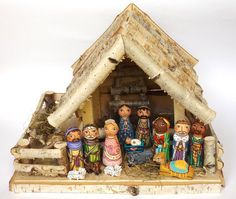 It's the nativity set featuring the Holy Family, the Three Kings, two shepherds with the angel and five animals (one camel, one dog, one donkey, and two sheeps). The shed was made of birch wood. The f