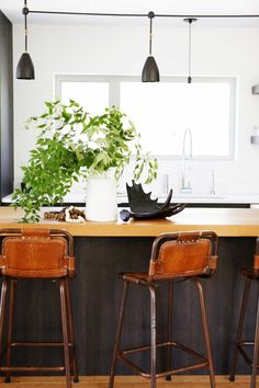 Modern kitchen with industrial light fixtures // Home Tour: A Perfectly Balanced Creative Seattle Pad