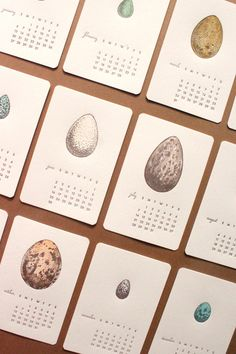 Let­ter­press cal­en­dar by Mink Letterpress. Each month fea­tures a pas­tel illus­tra­tion of a dif­fer­ent wild bird egg and min­i­mal typog­ra­phy.
