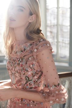 New for Pre Fall 2018, the Paradise Dress in Vintage Rose is the ultimate statement gown for event season. This embellished pink tulle midi dress is fully adorned with pastel decoration and is made up of several tiers of ruffle panels The high neck styling is a nod to our 1920s inspiration, and the midi-length sheer sleeves keeps the look wearable throughout the season. A fitted bodice on this pink knee length dress is finished with our signature pink grosgrain ribbon at the waist. Long Floral Maxi Dress, Floral Gown, Pastel Decor, Embellished Gown, Romantic Lace, Pink Tulle, Needle And Thread, Fitted Bodice, Homecoming Dresses