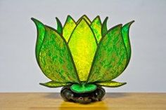 Find the unique and exotic with this Blooming Lotus Table Lamp - Lime from Om Gallery. Choose from a dazzling selection of fair trade products from jewelry to garden décor and home lighting!