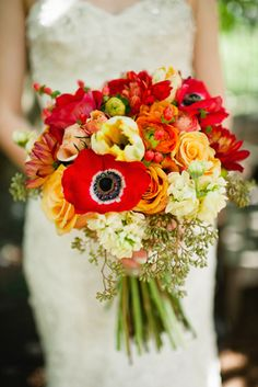 A gorgeous oversized bouquet of vibrant reds and burnt orange. Source: Spindle Photography #oversizedbouquets  #red #orange