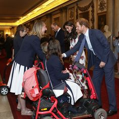Prince Harry greeted athletes who competed to help Great Britain win 67 medals at the Olympics and 147 medals at the Paralympics, both in Rio this summer.