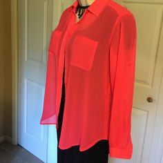 🎀GORGEOUS VS CORAL PINK BLOUSE🎀 The color is a knock out on this Victoria's Secret blouse. It is sheer and longer in the back. Absolutely new condition. Victoria's Secret Tops Blouses