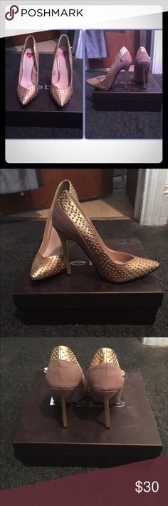 Bebe Gold/Brown Faux Suede Pump (never worn) Bebe pumps size 7. These have never been worn but do not come with a box. The box pictured contains another pair of shoes I'm selling. The heel height is estimated 5 inches. The pumps are gold with a light brown faux suede detail. A small gold skull is on the shoe - great if you're a bit of a fashion rocker (pretty unnoticeable if you aren't) bebe Shoes Heels