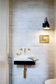 for powder room: modern floating sink - interesting light fixture and art - gold fixtures also interesting. This is my powder room. Bathroom Interior, Modern Bathroom, Small Bathroom, Bathroom Art, Washroom, Small Sink, White Bathrooms, Marble Bathrooms, Design Bathroom