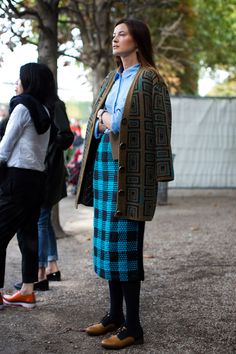 Street Style: Mixed geometric print knit with bold gingham pencil skirt at Fashion Week via Sartorialist.