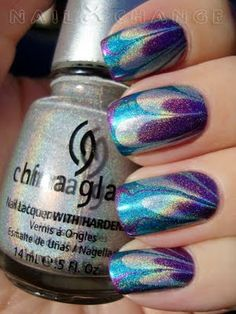 Gorgeous water marbling using China Glaze Cheers To You as a base, then marbled with China Glaze LOL, China Glaze DV8 and China Glaze OMG.