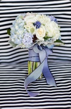 Blue wedding bouquet designed with hydrangea, muscari (grape hyacinth), scabiosa, roses, ranunculus and dusty miller foliage. I'm in LOVE with this ribbon too :)