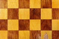 fragment of a old wooden chess board closeup abstract background
