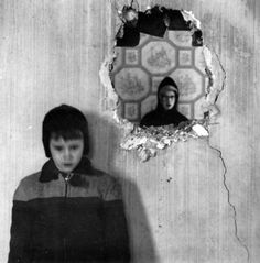 Ralph Eugene Meatyard • Two Boys, one seen though Hole in Wall