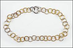 A POMELLATO DIAMOND, 18 KARAT WHITE GOLD AND YELLOW GOLD CIRCLE LINK NECKLACE. Lot 150-7202 #jewelry