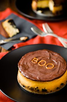"""These mini orange cheesecakes topped with dark chocolate ganache are packed with flavor. Decorate them with a white chocolate Halloween """"BOO"""" for extra fun! Continue reading →"""