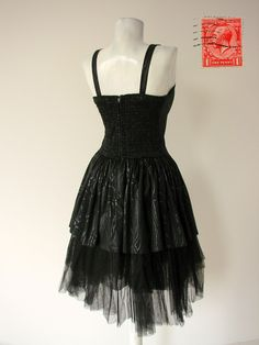 Black Tulle Dress with detachable straps. The bodice is fitted to just below the waist where it is cut into 2 V's. The back is elasticated and has a zipper to ensure a comfortable and flattering fit. Layered with 2 generous rows of Tulle. Size: S (bust - max. 32 inch 76 cm, waist - max. 26 inch 66 cm) Condition: Excellent