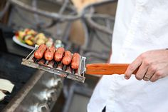 Evenly grilled hot dogs every time with a grill-top hot dog roller!