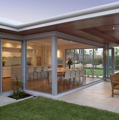 design ideas for our house...love the timber ceiling outside plus the nice big glass sections and doors