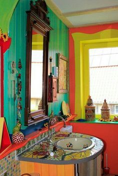 hot, hot, hot! Brightly colored powder room w/ mosaic topped vanity