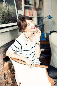 Simplistic French Girl style with the stripes and bold red lip.