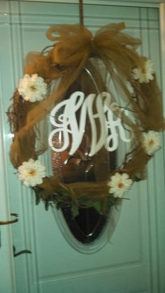 """Initials from """"Initial Outfitters"""" painted white, grapevine wreath, tulle, silk flowers!"""