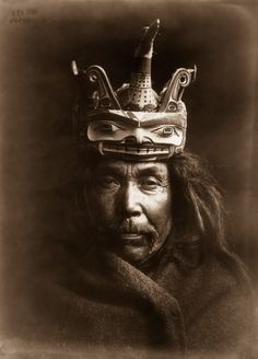 1914 - A Kwakiutl man wearing a mask depicting a man transforming into a loon. IMAGE: EDWARD S. CURTIS/LIBRARY OF CONGRESS